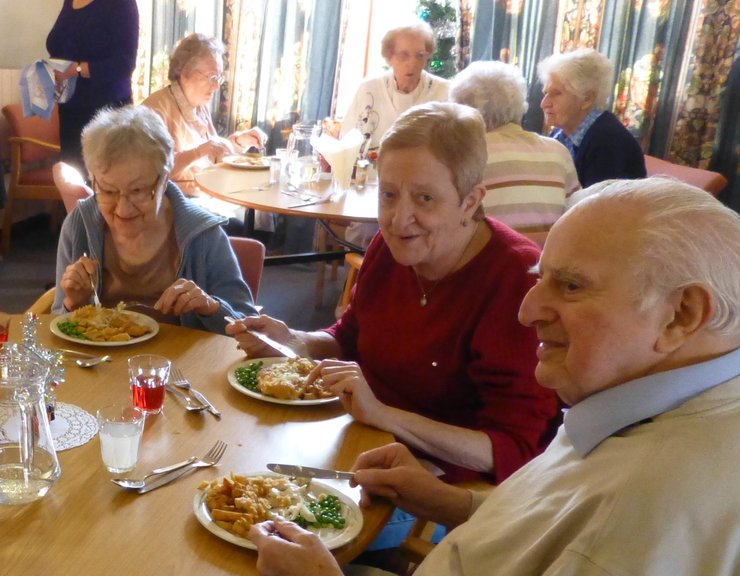 members enjoying a fish and chip lunch